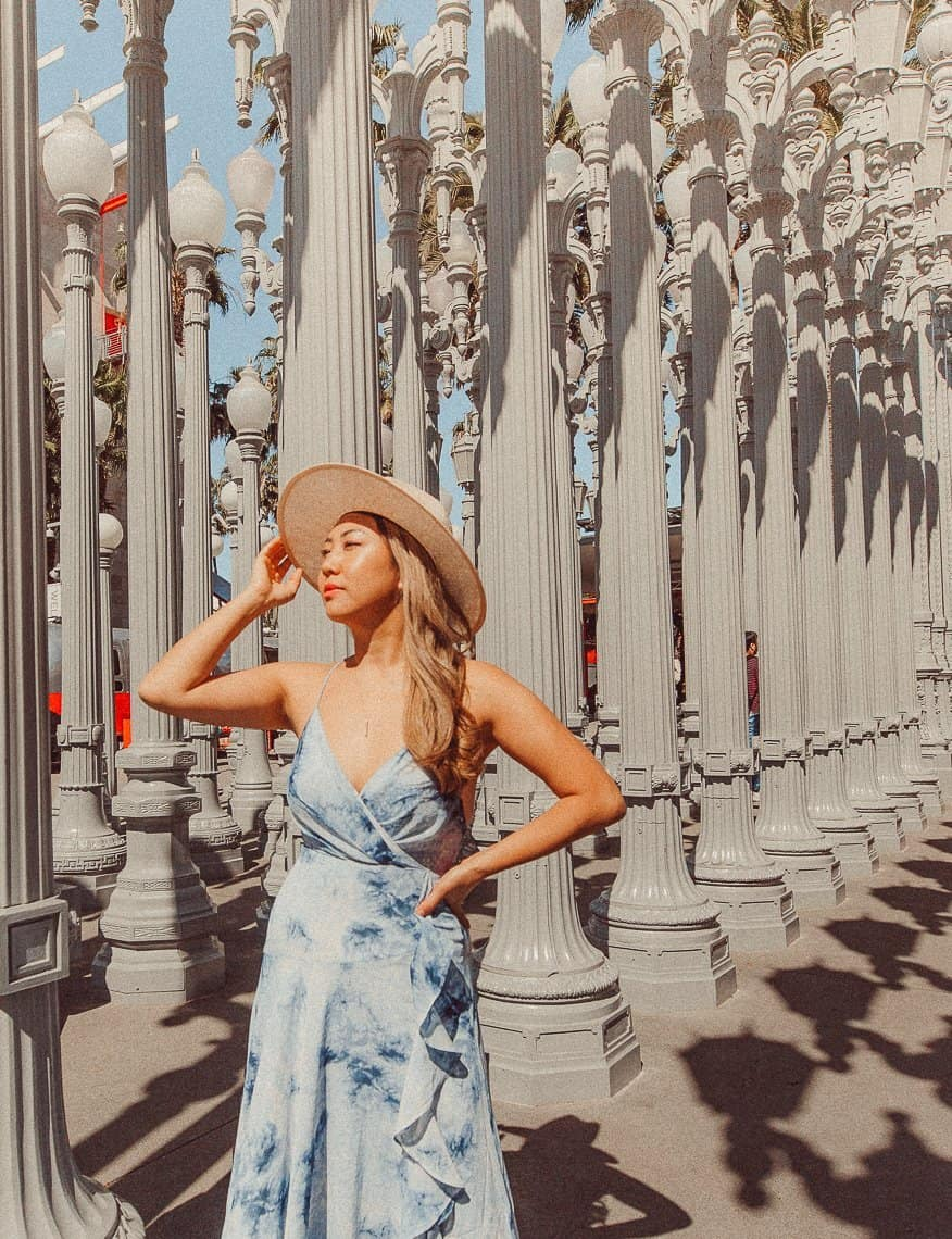 Sarah Chetrit is a travel content creator and an SEO educator who has a free blogging course and SEO course for bloggers. Here she is standing in front of LACMA.